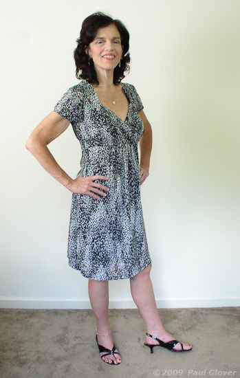 Kelli in black and white dress with heals